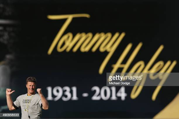 Coach Damien Hardwick gestures in front of the billboard in honour of the late Tom Hafey during a Richmond Tigers AFL training session at ME Bank...