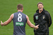 Coach Damien Hardwick reacts with Jack Riewoldt during a Richmond Tigers AFL training session at ME Bank Centre on June 13 2013 in Melbourne Australia