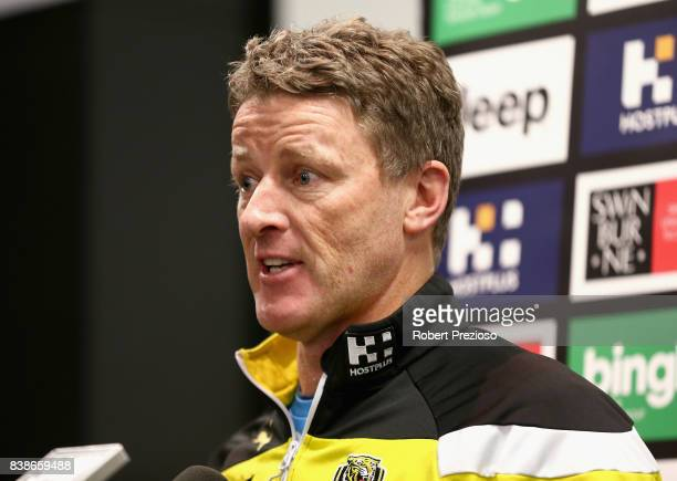 Coach Damien Hardwick speaks prior to a Richmond Tigers AFL training session at Punt Road Oval on August 25 2017 in Melbourne Australia