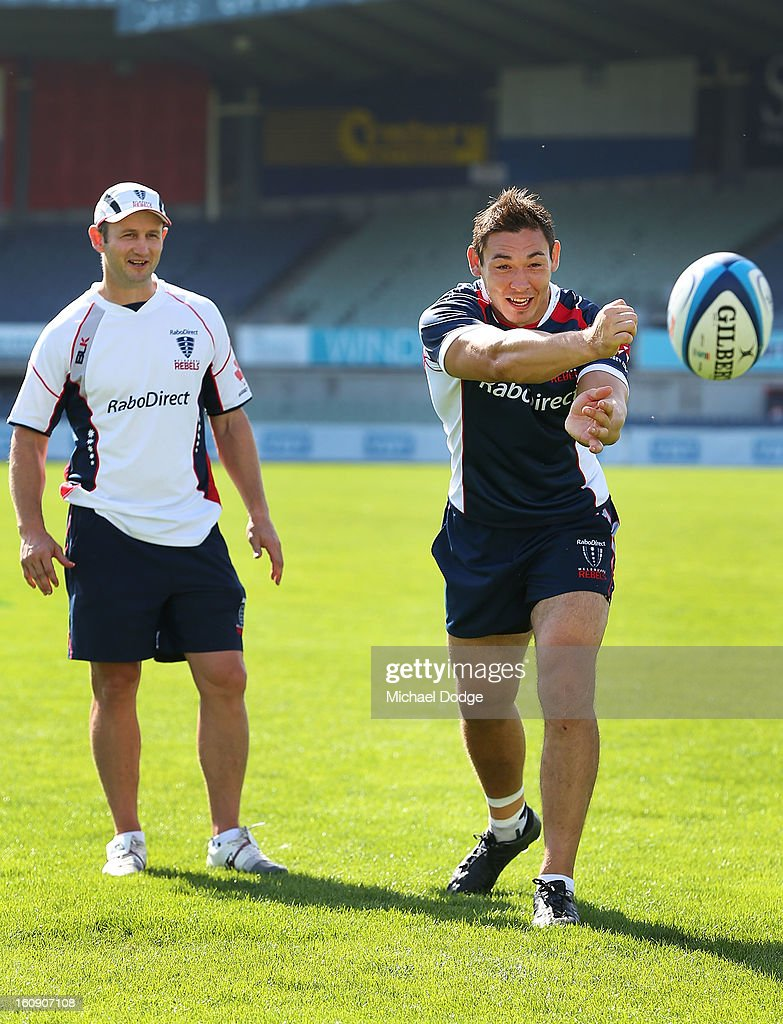 Coach Damien Hill watches new team Captain Gareth Delve pass the ball during the Melbourne Rebels 2013 captaincy announcement at Visy Park on February 8, 2013 in Melbourne, Australia.