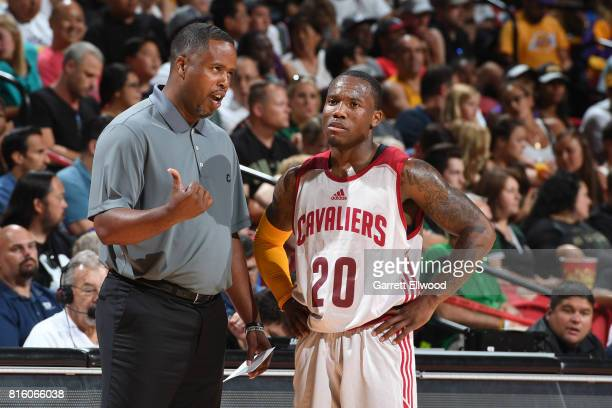 Coach Damon Jones talks to Kay Felder of the Cleveland Cavaliers in a game against the Milwaukee Bucks on July 7 2017 at the Thomas Mack Center in...