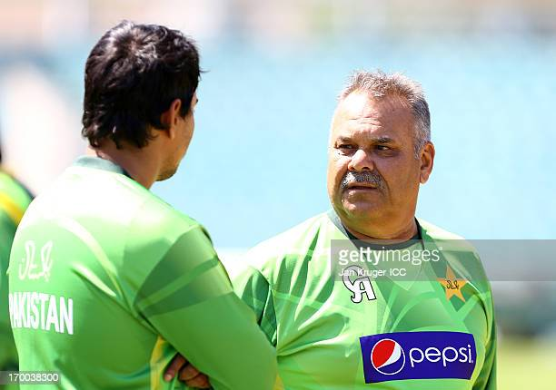 Coach Dav Whatmore speaks with Nasir Jamshed during a nets session at The Kia Oval on June 5 2013 in London England