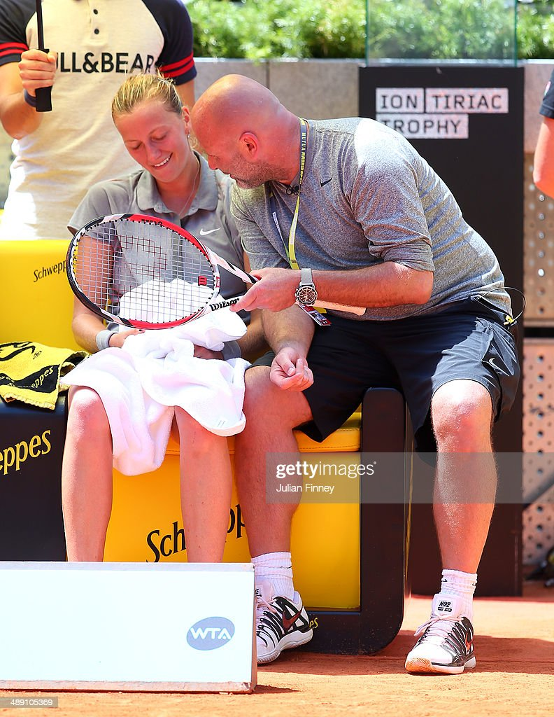 Coach David Kotyza shares a joke with Petra Kvitova of Czech Republic in her match against Simona Halep of Romania during day eight of the Mutua Madrid Open tennis tournament at the Caja Magica on May 10, 2014 in Madrid, Spain.