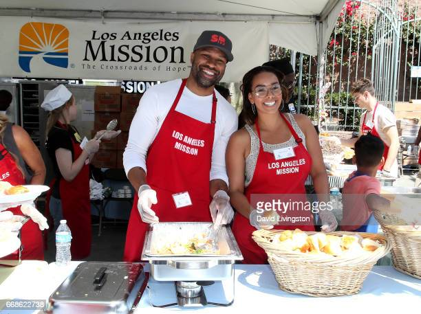 NBA coach Derek Fisher and Gloria Govan attend Los Angeles Mission's Easter Celebration at Los Angeles Mission on April 14 2017 in Los Angeles...