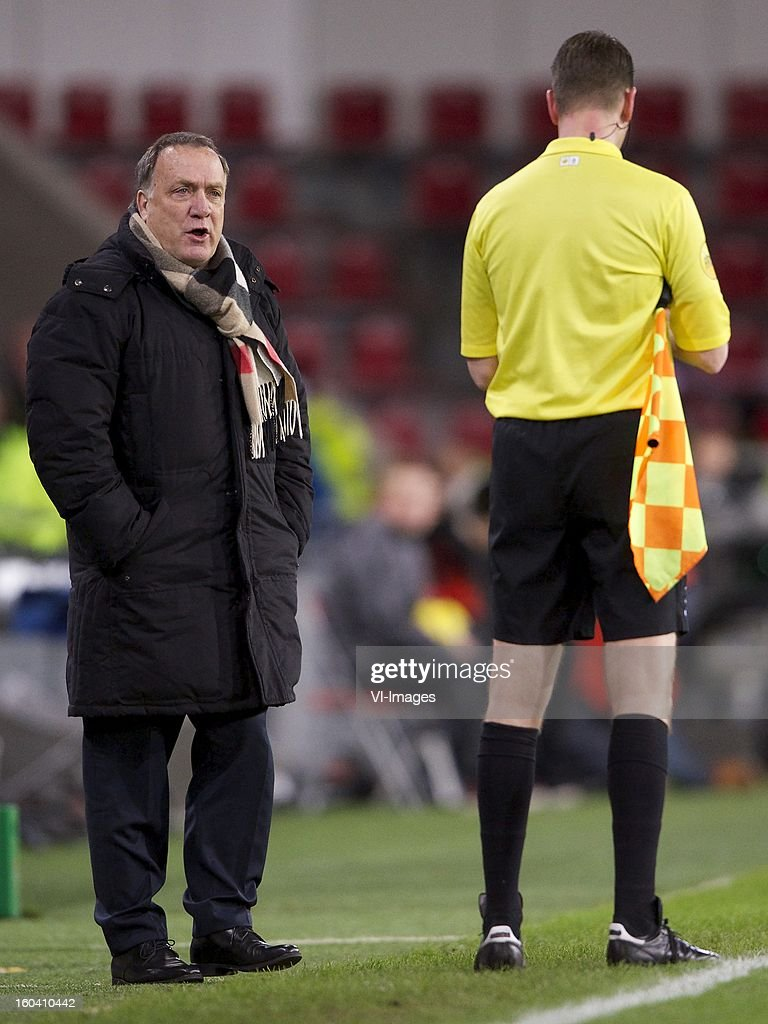 coach Dick Advocaat of PSV, assistant referee Patrick Langkamp during the Dutch Cup match between PSV Eindhoven and Feyenoord at the Philips Stadium on january 30, 2013 in Eindhoven, The Netherlands
