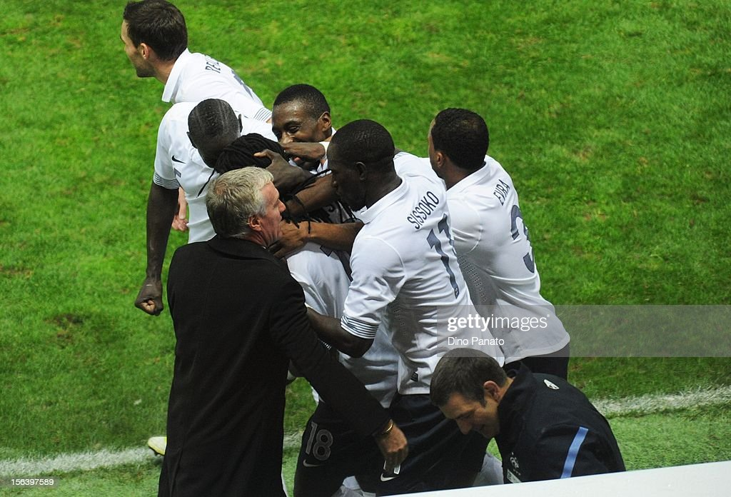 Coach Didier Deschamps and team-mates celebrate with Bafetimbi Gomis of France after he had scored the winning goal during the international friendly match between Italy and France at Stadio Ennio Tardini on November 14, 2012 in Parma, Italy.