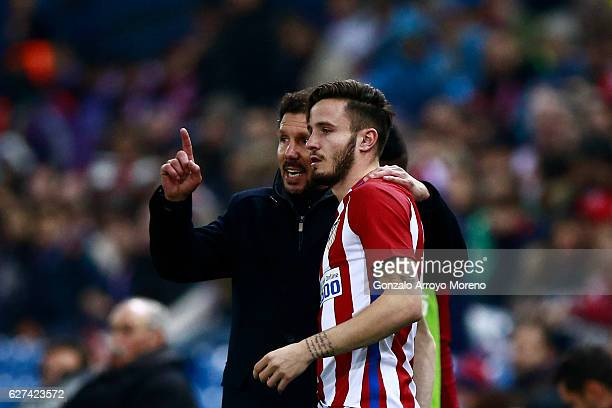 Coach Diego Pablo Simeone of Atletico de Madrid gives instructions to his player Saul Niguez during the La Liga match between Club Atletico de Madrid...