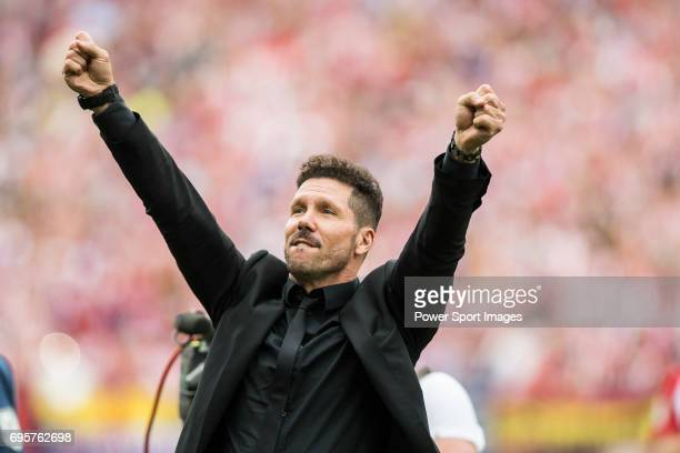 Coach Diego Simeone of Atletico de Madrid waves to supporters at the end of the La Liga match between Atletico de Madrid and Athletic de Bilbao at...
