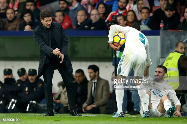 coach Diego Simeone of Atletico Madrid Raphael Varane of Real Madrid Dani Carvajal of Real Madrid during the Spanish Primera Division match between...