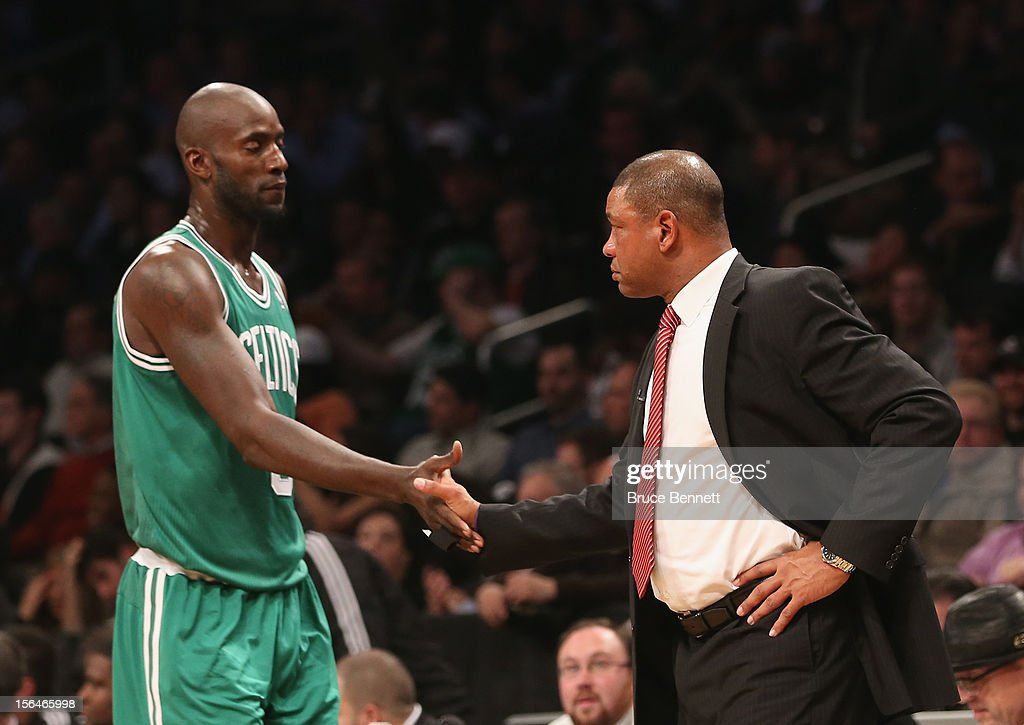 Coach Doc Rivers greets Kevin Garnett #5 of the Boston Celtics as he returns to the bench in the game against the Brooklyn Nets at the Barclays Center on November 15, 2012 in the Brooklyn borough of New York City.