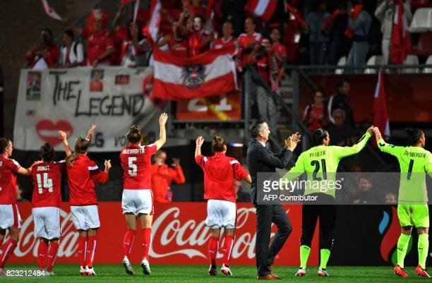 Coach Dominik Thalhammer applauds as Austria team celebrates in front of supporters as they defeat 30 Iceland during the UEFA Womens Euro 2017...
