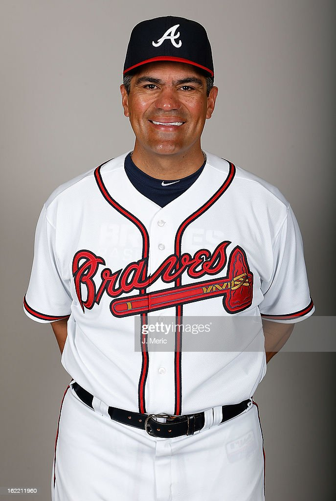 Coach Eddie Perez #12 of the Atlanta Braves poses for a photo during photo day at Champion Stadium at the ESPN Wide World of Sports Complex at Walt Disney World on February 20, 2013 in Lake Buena Vista, Florida.