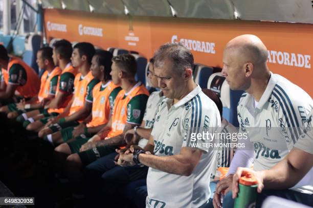 Coach Eduardo Baptista of Brazil's Palmeiras looks at his watch during their Copa Libertadores football match with Argentina's Atletico Tucuman in...