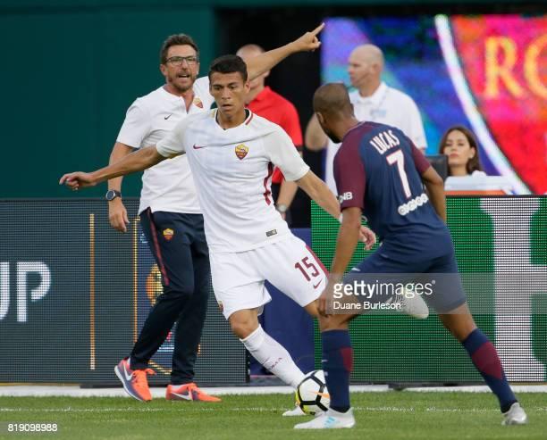 Coach Eusebio Di Francesco of AS Roma gives directions as Hector Moreno of AS Roma moves the ball against Lucas Moura of Paris SaintGermain during...