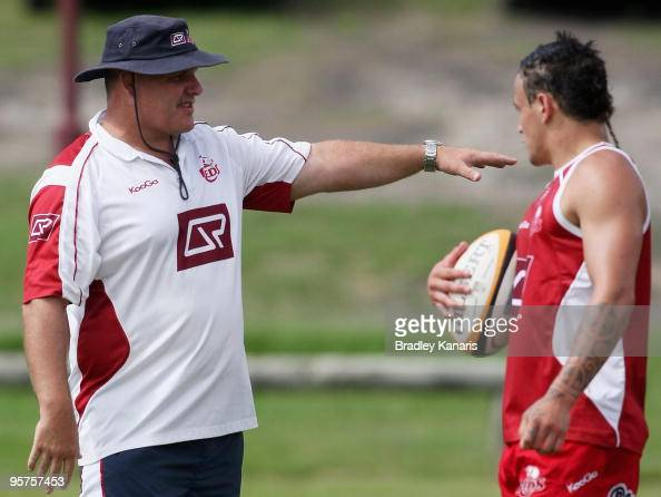 Coach Ewen McKenzie gives instructions to Richard Kingi during a Reds Super 14 training session at Ballymore Stadium on January 14 2010 in Brisbane...