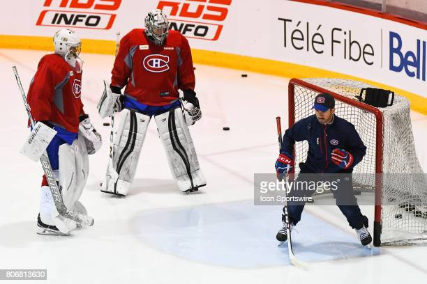Coach explaining exercise to Montreal Canadiens Rookie goalie Hayden Hawkey and Montreal Canadiens Rookie goalie Cayden Primeau during the Montreal...