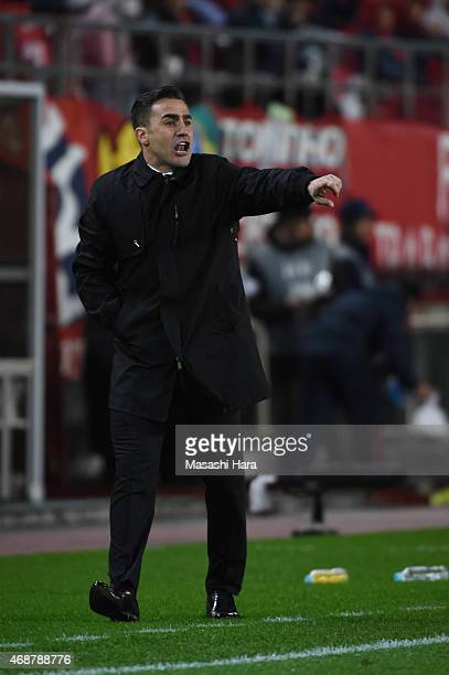 Coach Fabio Cannavaro of Guangzhou Evergrande issues instructions during the AFC Champions League Group H match between Kashima Antlers and Guangzhou...