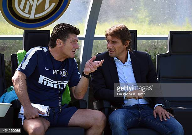 Coach FC Internazionale Walter Mazzarri and Coach Italy Antonio Conte during FC Internazionale Training Session at Appiano Gentile on August 27 2014...