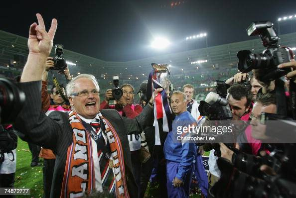 Coach Foppe De Haan of Holland poses with the trophy for photographers after the UEFA U21 Championship Final match between Netherlands U21 and Serbia...