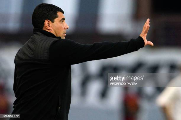 Coach Francesco Stifano of Venezuela's Zamora gives instructions to his players during their Copa Libertadores football match against Brazil's Gremio...
