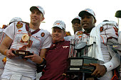 Coach Frank Beamer of the Virginia Tech Hokies on the victory stand with quarterbacks Sean Glennon and Tyrod Taylor after play against the Boston...