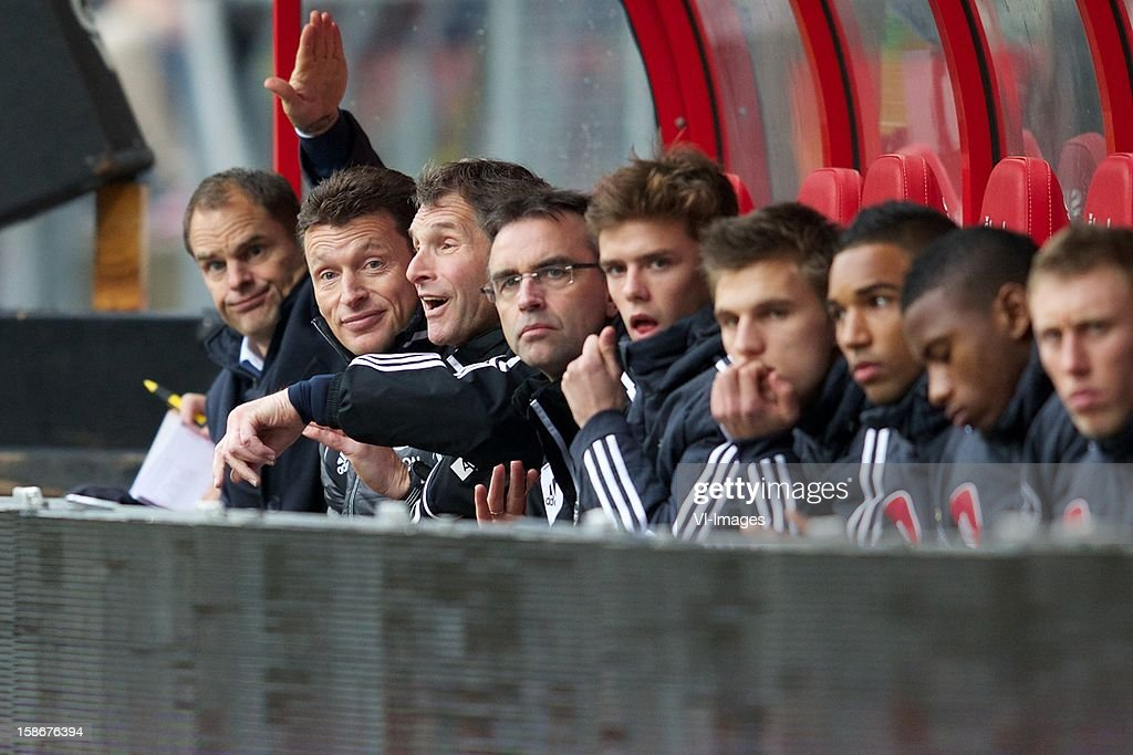 coach Frank de Boer of Ajax, goalkeeper coach Carlo l'Ami, physiotherapist Pim van Dord during the Dutch Eredivise match between FC Utrecht and Ajax Amsterdam at the Galgenwaard on December 23, 2012 in Utrecht, The Netherlands.