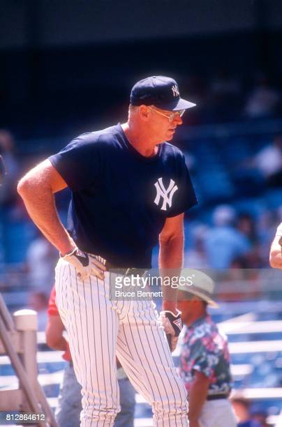 Coach Frank Howard of the New York Yankees stands on the field near the batting cage before an MLB game against the Milwaukee Brewers on May 23 1992...