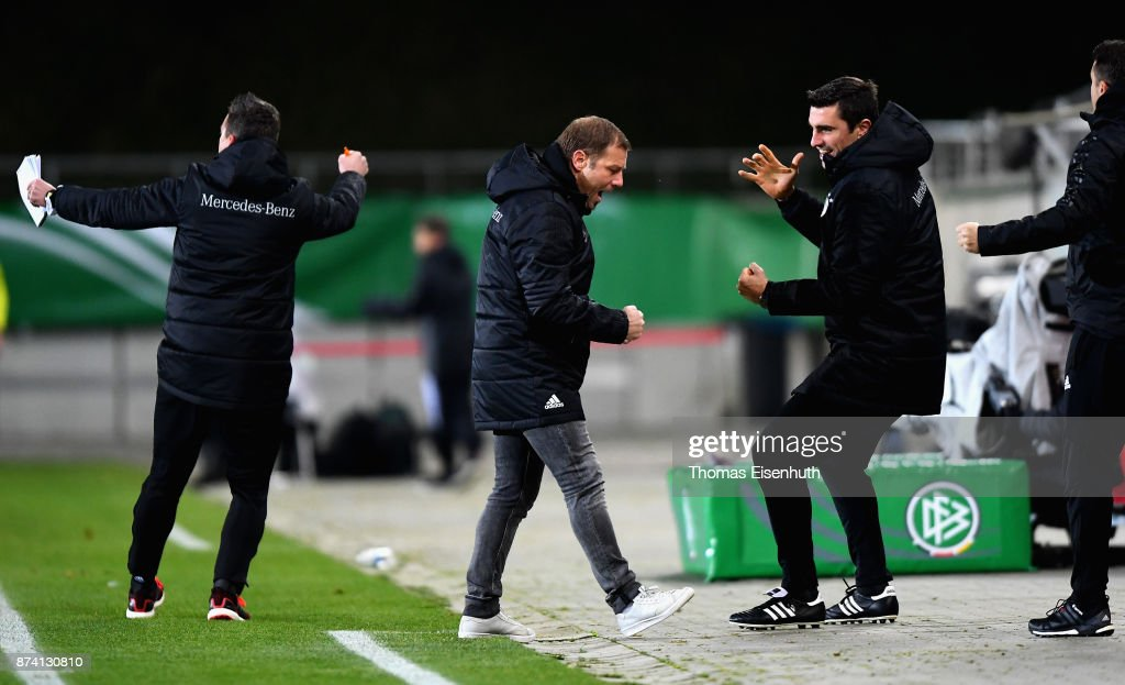 Coach Frank Kramer (2nd left) of Germany celebrates after the opening goal during the Under 20 International Friendly match between U20 of Germany and U20 of England at Stadion Zwickau on November 14, 2017 in Zwickau, Germany.