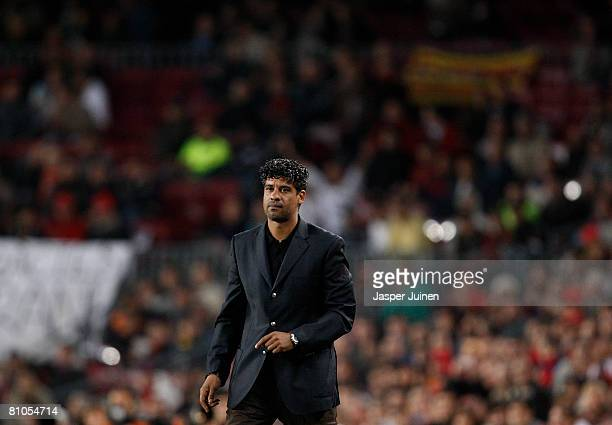 Coach Frank Rijkaard of Barcelona follows his players on to the pitch during his last La Liga home match between Barcelona and Mallorca at the Camp...