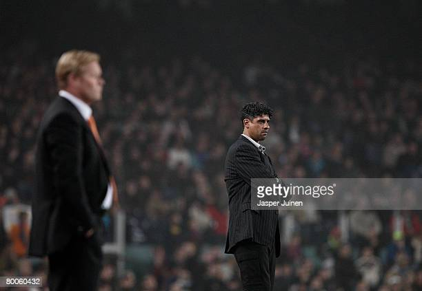 Coach Frank Rijkaard of Barcelona looks at his players flanked by his fellow countryman coach Ronald Koeman of Valencia during the Copa del Rey semi...
