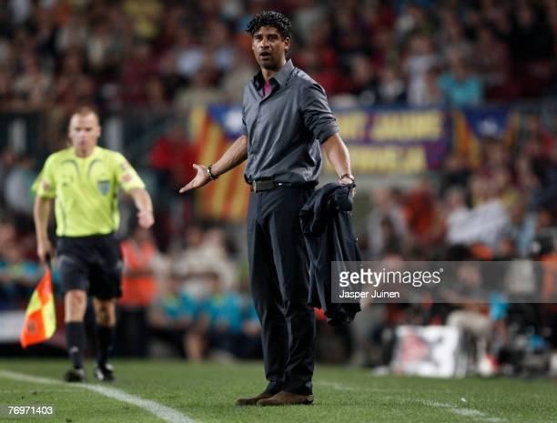 Coach Frank Rijkaard of Barcelona reacts to the referee for not finishing the match at the end of the Spanish League soccer match between Barcelona...