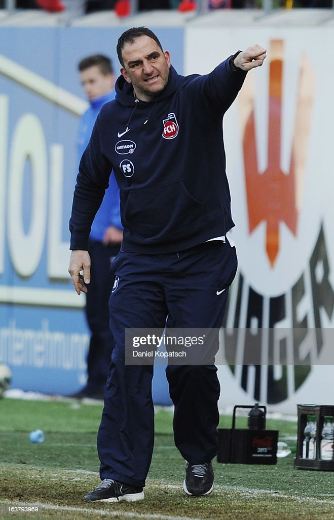 Coach <a gi-track='captionPersonalityLinkClicked' href=/galleries/search?phrase=Frank+Schmidt&family=editorial&specificpeople=5890182 ng-click='$event.stopPropagation()'>Frank Schmidt</a> of Heidenheim reacts during the third Bundesliga match between 1. FC Heidenheim and Wacker Burghausen at Voith-Arena on March 16, 2013 in Heidenheim, Germany.