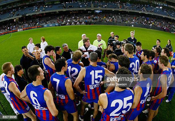 Coach Gary Ayres of Port Melbourne talks to his players during the VFL Grand Final match between North Ballarat and Port Melbourne held at the...