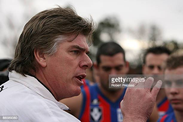 Coach Gary Ayres of Port Melbourne talks to his players during the round 10 VFL match between the Port Melbourne Boroughs and the Coburg Tigers at...