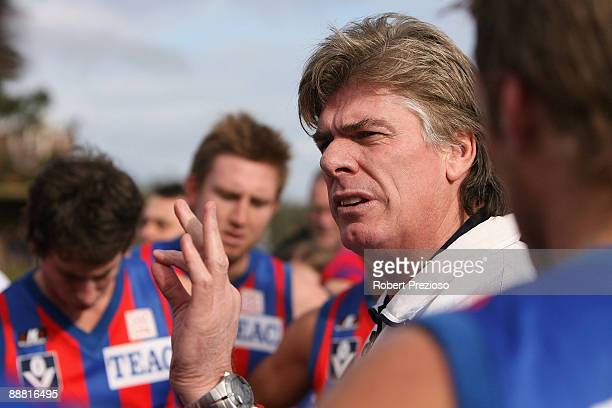 Coach Gary Ayres of Port Melbourne talks to his players during the round 12 VFL match between Sandringham and Port Melbourne at Trevor Barker Beach...