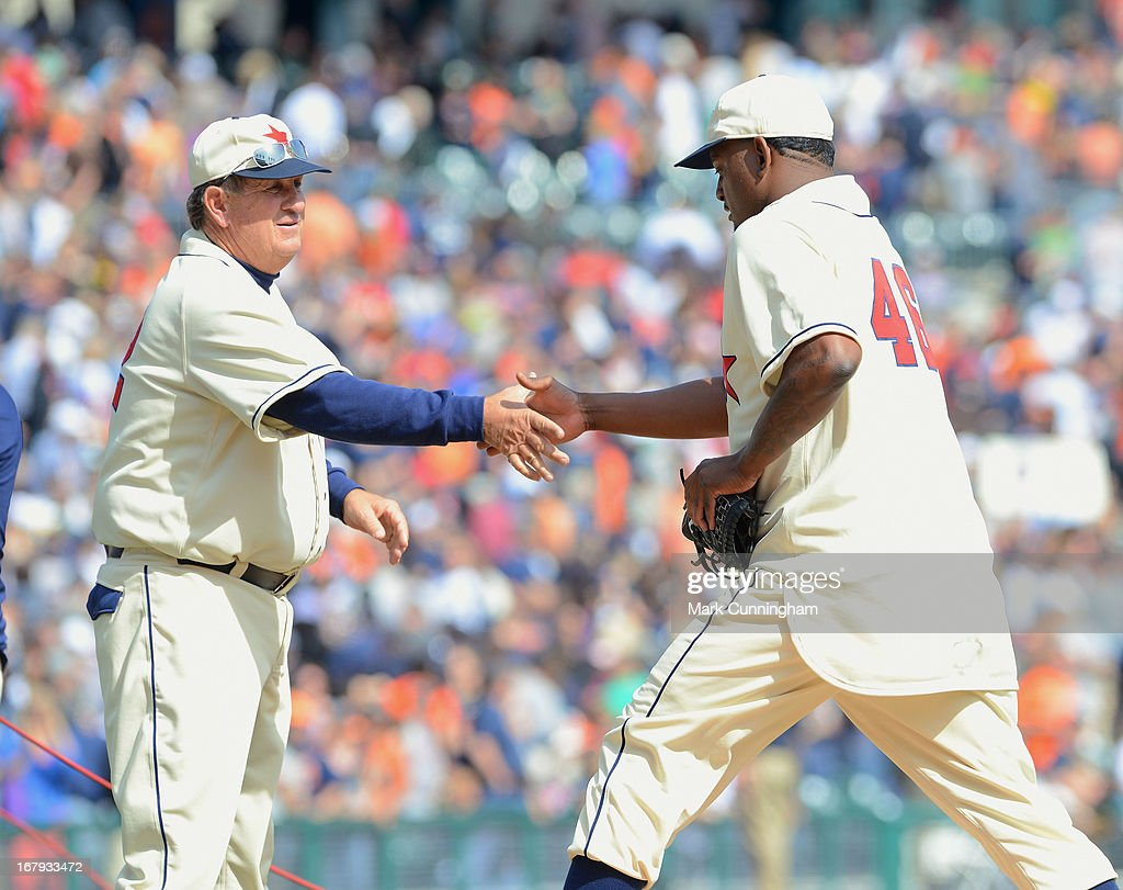 Coach Gene Lamont #22 and Jose Valverde #46 of the Detroit Tigers shake hands while wearing Detroit Stars Negro League Tribute uniforms after the victory against the Atlanta Braves at Comerica Park on April 27, 2013 in Detroit, Michigan. The Tigers defeated the Braves 7-4.