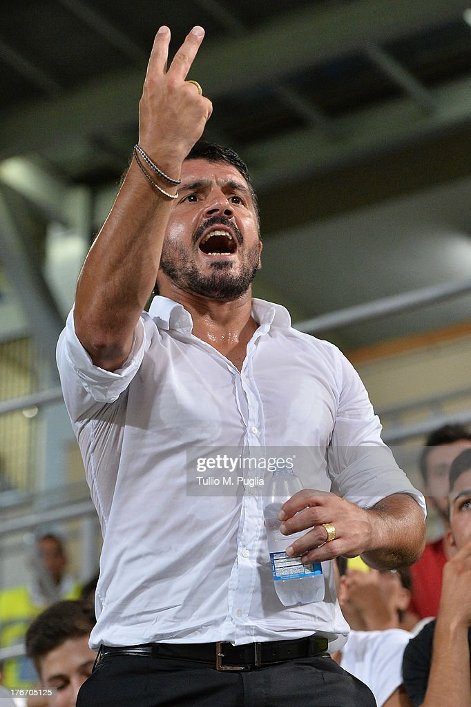 Coach Gennaro Gattuso of Palermo issues instructions from the stand after receiving a red card from referee during the TIM Cup match between US Citta di Palermo and Hellas Verona at Stadio Renzo Barbera on August 17, 2013 in Palermo, Italy.