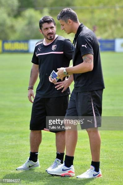 Coach Gennaro Gattuso speaks with Igor Budan during a US Citta di Palermo preseason training session at Sportzentrum on July 12 2013 in Sankt...