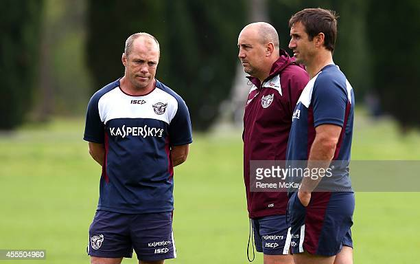 Coach Geoff Toovey talks with Andrew Johns and David Penna during a Manly Sea Eagles NRL training session on September 16 2014 in Sydney Australia
