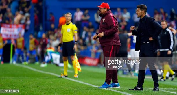 coach German Burgos and Head coach Diego Simeone of Atletico Madrid gestures during the UEFA Champions League Quarter Final first leg match between...