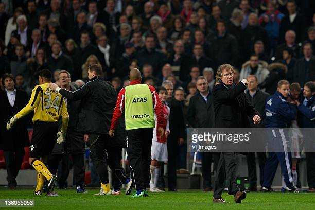 Coach Gert Jan Verbeek of AZ orders his players to leave the pitch after an incident in which his goalkeeper Esteban Alvarado Brown of AZ received a...