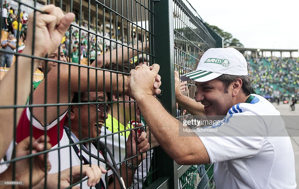 Coach Gilson Kleina of Palmeiras celebrates after the match between Palmeiras and Boa Esporte for the Brazilian Championship Series B 2013 at Pacaembu Stadium on November 16, 2013 in Sao Paulo, Brazil.