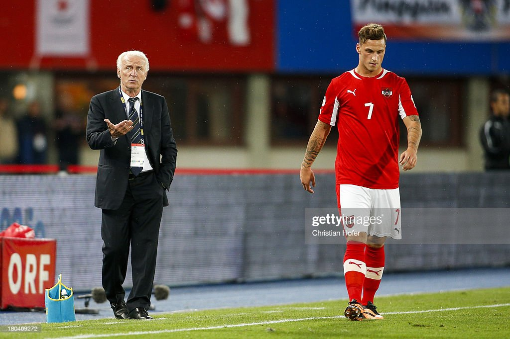 Coach Giovanni Trapattoni of Ireland reacts next to Marko Arnautovic of Austria during the FIFA World Cup 2014 Group C qualification match between Austria and the Republic of Ireland at the Ernst Happel Stadium on September 10, 2013 in Vienna, Austria.