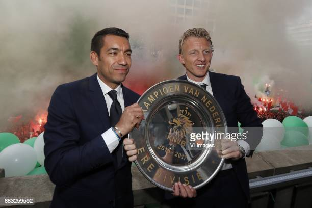 coach Giovanni van Bronckhorst Dirk Kuyt of Feyenoord with the tropheeduring Feyenoord Rotterdam honored Eredivisie champions at the Coolsingel on...
