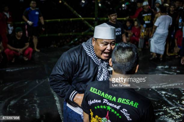 A coach gives instructions to his student during his Pencak Dor competition at the yard of Lirboyo islamic boarding school on April 29 2017 in Kediri...