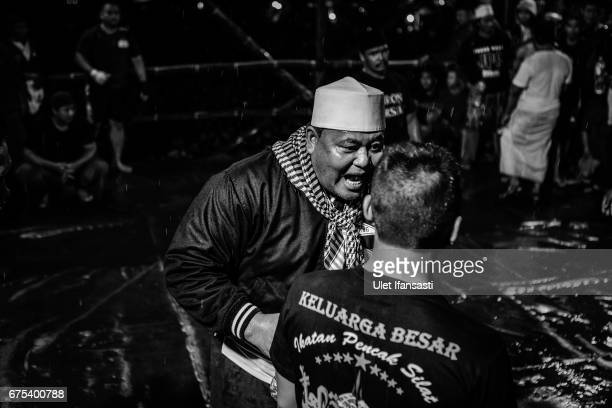 A coach gives instructions to his student during Pencak Dor competition at the yard of Lirboyo islamic boarding school on April 29 2017 in Kediri...