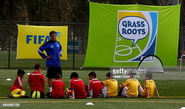 A coach gives intrutions during the FIFA Grassroots Festival at Parque Deportivo de la Caja on October 30 2015 in Santiago Chile