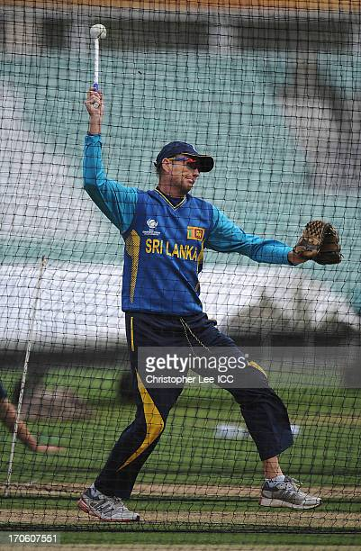 Coach Graham Ford preforms some throw downs to assist the batsmen during the Sri Lanka Nets Session at the Oval on June 15 2013 in London England