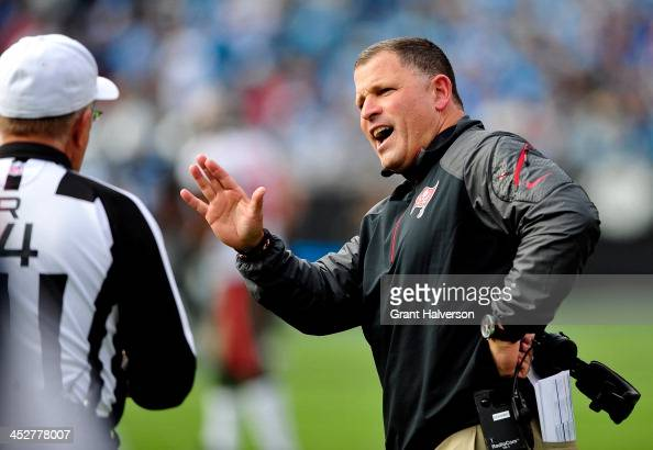 Coach Greg Schiano of the Tampa Bay Buccaneers argues with referee Ron Winter during play against the Carolina Panthers at Bank of America Stadium on...