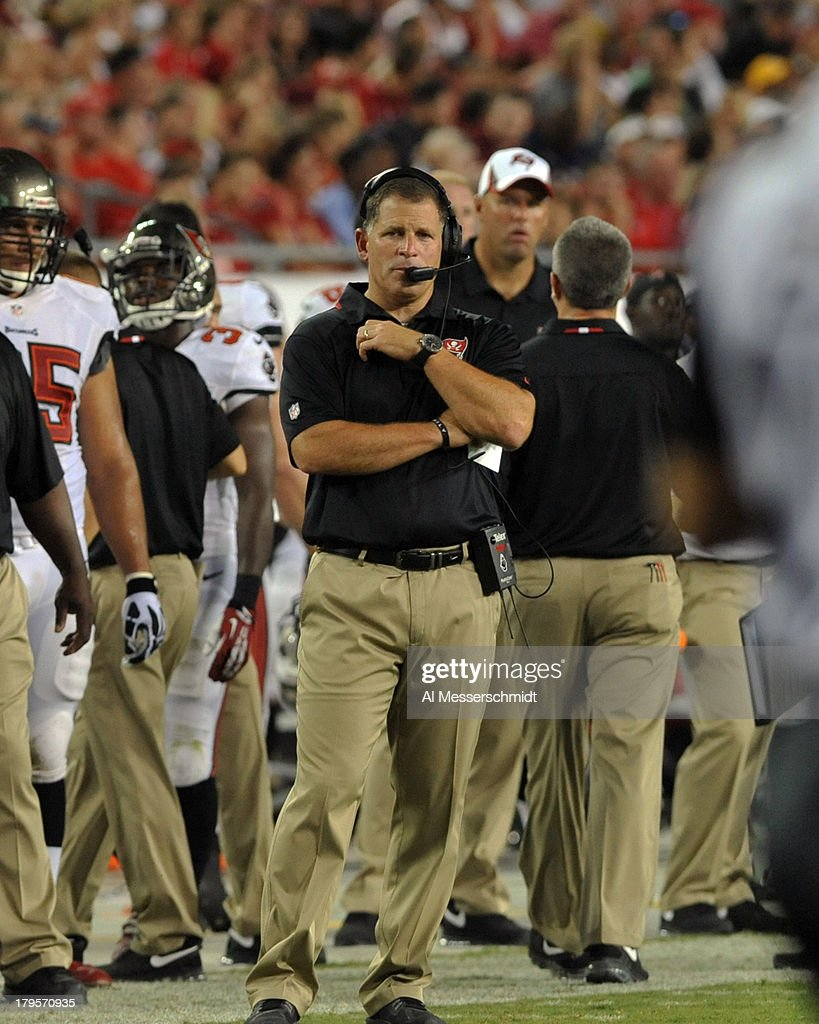 Coach Greg Schiano of the Tampa Bay Buccaneers directs play against the Washington Redskins August 29 2013 at Raymond James Stadium in Tampa Florida